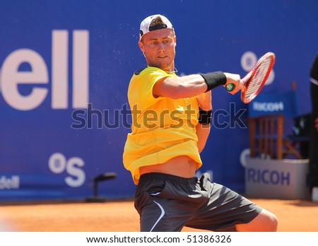 BARCELONA, SPAIN - APRIL 20: Australian Lleyton Hewitt playing in the Banc Sabadell Open ATP tennis tournament on April 20 2010 in Barcelona, Spain. - stock photo