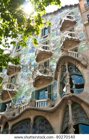 BARCELONA, SPAIN - APRIL 28: Exterior of Casa Batllo on APRIL 28, 2011, a building restored by great catalan architect Antoni Gaudi. Gaudi avoids straight lines completely. - stock photo