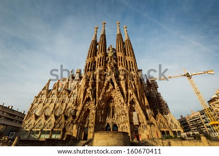 BARCELONA, SPAIN - April 10 2013: La Sagrada Familia - the impressive cathedral designed by Gaudi, which is being build since 19 March 1882 and is not finished yet April 10 2013in Barcelona, Spain. - stock photo
