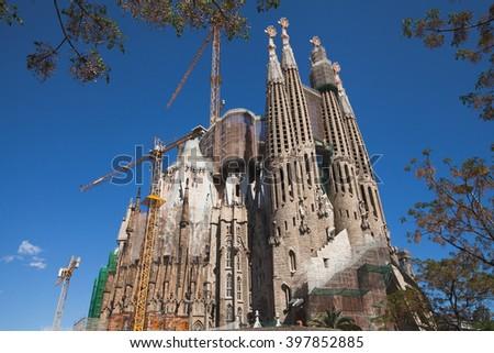 BARCELONA, SPAIN - APRIL 20, 2013: La Sagrada Familia - the impressive cathedral designed by Gaudi, still unfinished. - stock photo