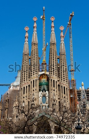 BARCELONA, SPAIN - APRIL 10: La Sagrada Familia - the impressive cathedral designed by Gaudi, which is being build since March 19 1882 and is not finished as of April 10, 2011 in Barcelona, Spain. - stock photo