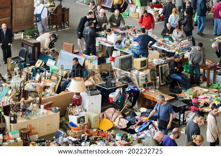 BARCELONA, SPAIN - APRIL 11, 2014: One of the stall selling used items and antiques at the famous market Encants Vells in the city of Barcelona. - stock photo