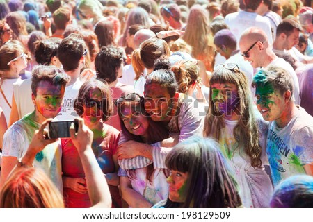 BARCELONA, SPAIN - APRIL 6, 2014: People at IV Festival de los colores Holi Barcelona. Holi is  holiday of Indian Culture