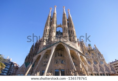 BARCELONA, SPAIN - APRIL 22: Sagrada Familia in April 22, 2012 in Barcelona, Spain. Basilica and Expiatory Church of Holy Family by Gaudi, building is begun in 1882 and completion is planned in 2030 - stock photo