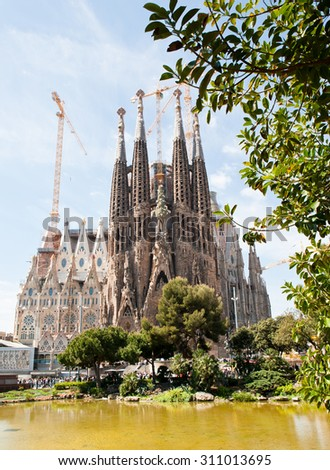BARCELONA, SPAIN - APRIL 23, 2015: Sagrada Familia is a Roman Catholic church in Barcelona, designed by Catalan architect Antoni Gaudi. Is not finished yet  - stock photo