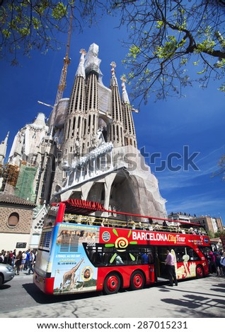BARCELONA, SPAIN - APRIL 30, 2015: The Basilica of La Sagrada Familia designed by Antoni Gaudi, its construction began in 1882 and is not finished yet. - stock photo