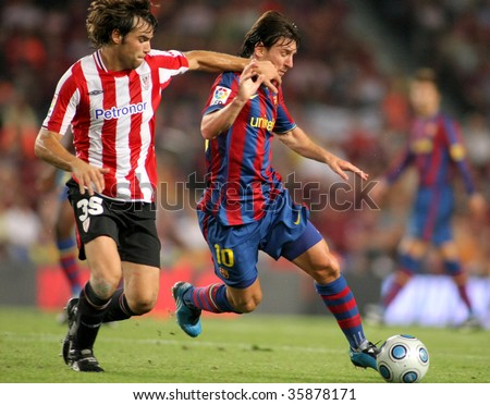 BARCELONA, SPAIN - AUG. 23: Futbol Club Barcelona argentinian star Leo Messi during Spanish Supercup match between Barcelona vs Athletic Bilbao at the New Camp Stadium in Barcelona on August 23, 2009. - stock photo
