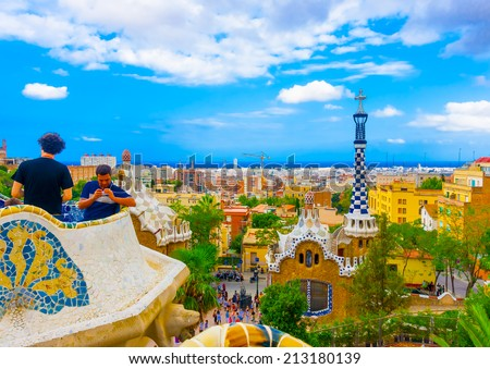BARCELONA, SPAIN -AUG 29, 2009: Unidentified tourists  in the famous Guell park in Barcelona, Spain on Aug 29, 2009.