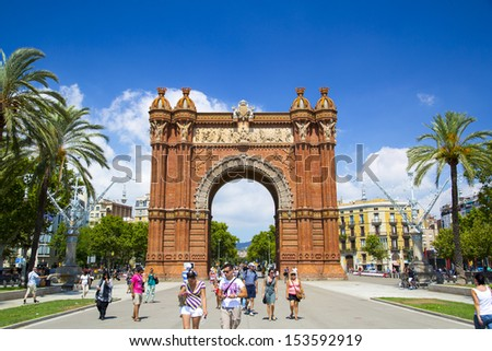 BARCELONA, SPAIN - AUGUST 10: Arc de Triomf on August 10, 2013 in Barcelona, Spain. Designed by Josep Vilaseca, it was built for the 1888 Universal Exposition as its main access gate