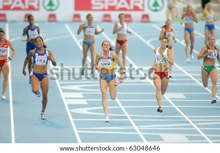BARCELONA, SPAIN - AUGUST 01: Competitors of 4X100 Relay during the 20th European Athletics Championships at the Olympic Stadium on August 1, 2010 in Barcelona, Spain - stock photo