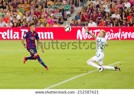 BARCELONA, SPAIN - AUGUST 18: Neymar Junior of FCB scores a goal at Gamper friendly match between FC Barcelona and Club Leon FC, final score 6-0, on August 18, 2014, in Camp Nou, Barcelona, Spain. - stock photo