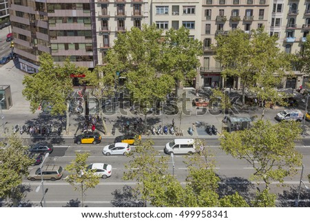 Barcelona, Spain - August 12, 2016, Passeig de Gracia in Barcelona, one of the most important arteries of the city, with traffic and pedestrians