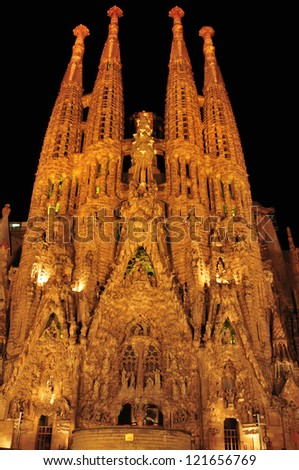 BARCELONA, SPAIN - AUGUST 15: Sagrada Familia at night on August 15, 2012 in Barcelona, Spain. The impressive cathedral designed by Antoni Gaudi is being built since 1882 and is not finished yet - stock photo