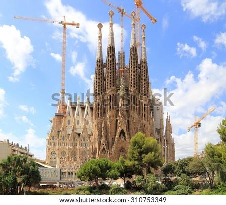 BARCELONA, SPAIN - AUGUST 9, 2015: Sagrada Familia basilica in Barcelona. The Antoni Gaudi masterpiece has become a UNESCO World Heritage Site in 1984. - stock photo