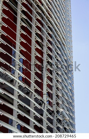 BARCELONA, SPAIN - AUGUST 3, 2014: Torre Agbar in Barcelona. The tower with a height of 144 meters was designed by Jean Nouvel and is a homage to the famous architect Antoni Gaudi. - stock photo