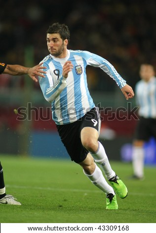 BARCELONA, SPAIN - DEC. 22: Argentinian player Gonzalo Higuain in action during the friendly match between Catalonia vs Argentina at Camp Nou Stadium Dec. 22, 2009 in Barcelona. - stock photo