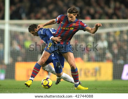 BARCELONA, SPAIN - DEC 12: Pareja (L) of Espanyol and Ibrahimovic (R) of Barcelona during Spanish league match between Barcelona and Espanyol at Camp Nou stadium December 12, 2009 in Barcelona, Spain. - stock photo