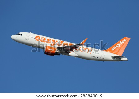 BARCELONA, SPAIN - DECEMBER 11:  An easyJet Airbus A320 taking off on December 11, 2014 in Barcelona. EasyJet is a British airline with its headquarters near London and some 240 planes in operation. - stock photo