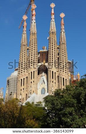 BARCELONA, SPAIN - december 11, 2015: Building the famous Catholic basilica of the Sagrada Familia in Barcelona, Catalonia, Spain. Designed by Antoni Gaudi. Start of construction, 1882 - stock photo