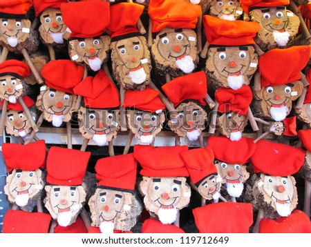 BARCELONA, SPAIN - DECEMBER 11: Caga tio, a character in Catalan mythology relating to a Christmas tradition in Catalonia, at the Santa Llucia Festival, on December 11, 2011, in Barcelona, Spain. - stock photo