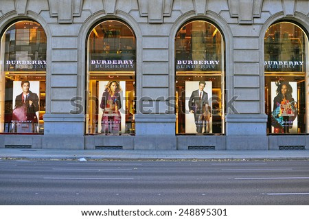 BARCELONA, SPAIN - DECEMBER 9: Facade of Burberry flagship store in the street of Barcelona on December 9, 2014. Burberry is a luxurious clothing brand based in Great Britian.  - stock photo