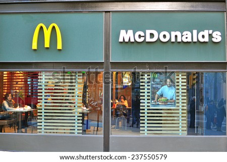 BARCELONA, SPAIN - DECEMBER 11: Front view of Mcdonald's restaurant in new green concept in Barcelona on December 11, 2014. McDonald's is the world's largest chain of fast food restaurants. - stock photo