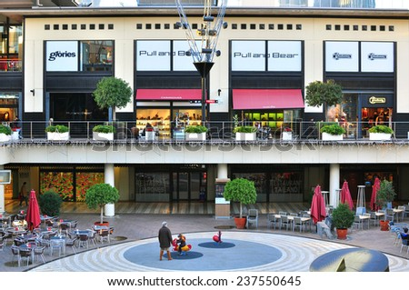 BARCELONA, SPAIN - DECEMBER 11: Front view of shops gallery in shopping centre in Barcelona on December 11, 2014. Barcelona is the second largest city of Spain. - stock photo