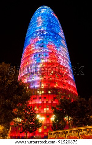 BARCELONA, SPAIN - DECEMBER 19: Torre Agbar on Technological District on December 19, 2011 in Barcelona, Spain. This 38-storey tower was designed by the famous architect Jean Nouvel. - stock photo