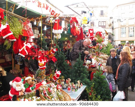 BARCELONA, SPAIN - DECEMBER 11: Unidentified people visit Santa Llucia Festival to buy Christmas decoration, such as pine trees and crib figures, on December 11, 2011, in Barcelona, Spain.
