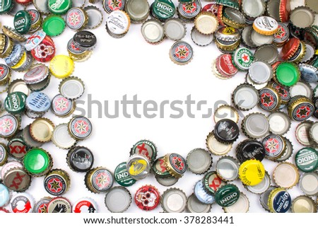 BARCELONA, SPAIN - FEB 17, 2016: Background of beer bottle caps, a mix of various  brands.