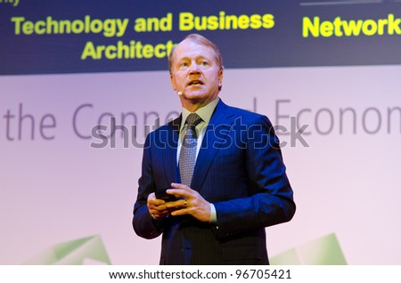 BARCELONA, SPAIN - FEB 27: John Chambers, Chairman & CEO, Cisco speaks about Exploring the Mobile Cloud at the GSMA MWC 2012 on Feb 27, 2012 in Barcelona, Spain - stock photo