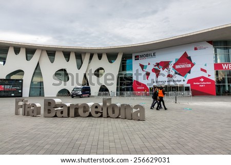 BARCELONA, SPAIN FEBRUARY 28: Every year, tens of thousands of reporters, analysts, and businesspeople attend the  Mobile World Congress trade show in Barcelona. February 28, 2015 in Barcelona, Spain  - stock photo