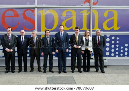 BARCELONA, SPAIN - FEBRUARY 26: HRH The Prince of Asturias Don Felipe de Borbon and other authorities visit the Mobile World Congress 2012, on February 26, 2012 in Barcelona, Spain - stock photo
