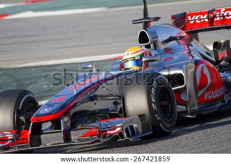 BARCELONA, SPAIN - FEBRUARY 21: Lewis Hamilton of McLaren F1 team racing at Formula One Teams Test Days at Catalunya circuit on February 21, 2012 in Barcelona, Spain. - stock photo