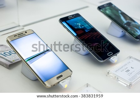 BARCELONA, SPAIN - FEBRUARY 27, 2016: New Samsung Galaxy phones presented at Mobile World Centre of Barcelona during Mobile World Congress 2016 in Barcelona, Spain. - stock photo