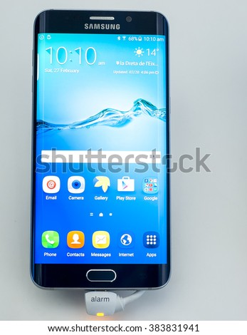 BARCELONA, SPAIN - FEBRUARY 27, 2016: New Samsung Galaxy S6 Edge presented at Mobile World Centre of Barcelona during Mobile World Congress 2016 in Barcelona, Spain. - stock photo