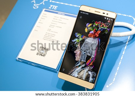 BARCELONA, SPAIN - FEBRUARY 27, 2016: New ZTE Axon presented at Mobile World Centre of Barcelona during Mobile World Congress 2016 in Barcelona, Spain. - stock photo