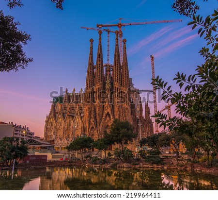 BARCELONA, SPAIN - FEBRUARY 24: Sagrada Familia on February 24, 2012: La Sagrada Familia - the impressive cathedral designed by Gaudi, which is being built since 19 March 1882 and is not finished yet. - stock photo