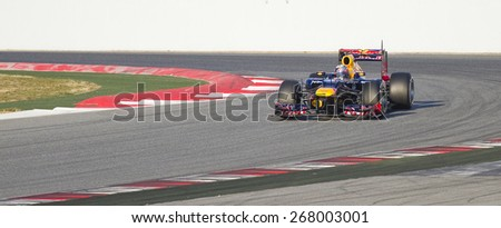 BARCELONA, SPAIN - FEBRUARY 21: Sebastian Vettel of Red Bull F1 team racing at Formula One Teams Test Days at Catalunya circuit on February 21, 2012 in Barcelona, Spain. - stock photo