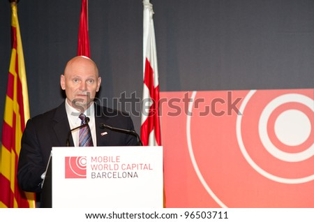BARCELONA, SPAIN - FEBRUARY 26: The CEO of GSMA Ltd, John Hoffman speaks at the official inauguration act at the Mobile World Congress 2012, on February 26, 2012 in Barcelona, Spain - stock photo