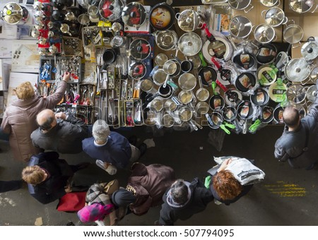 BARCELONA, SPAIN - JANUARY 09, 2016: Crowded flea market in Barcelona, Spain, called Mercat dels Encants. The Fira de Bellcaire is an old market for second hand goods, also known as Encants Vells