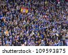 BARCELONA, SPAIN - JANUARY 8: RCD Espanyol supporters cheering at the Spanish league match between RCD Espanyol and FC Barcelona, final score 1-1, on January 8, 2012, in Barcelona, Spain. - stock photo