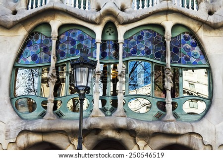 Barcelona, Spain - January 27, 2015: The facade of the house Casa Battlo (also could the house of bones) designed by Antoni Gaudi with his famous expressionistic style  - stock photo