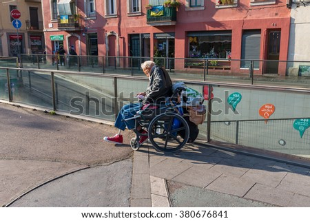 BARCELONA, SPAIN - JANUARY 21. Wheelchair user sell raffle tickets at the Mercat de la Barceloneta on January 21, 2016. The man earns his living with selling tickets in Barcelona - stock photo