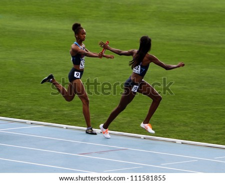 BARCELONA, SPAIN - JULY 15: American team - the winners of the 400 meters relay race on th 2012 IAAF World Junior Athletics Championshipson on July 15, 2012 in Barcelona, Spain. - stock photo