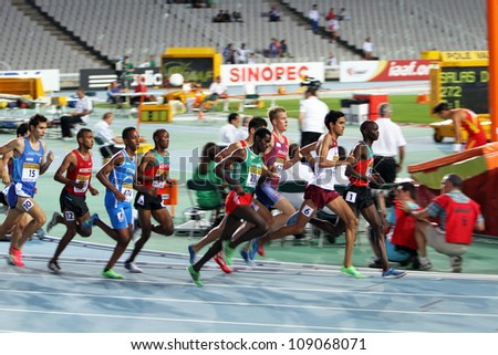 BARCELONA, SPAIN - JULY 12: athletes compete in the 1500 meters final on the 2012 IAAF World Junior Athletics Championships on July 12, 2012 in Barcelona, Spain. - stock photo