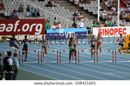BARCELONA, SPAIN - JULY 14: athletes compete in the 400 meters hurdles final on the 2012 IAAF World Junior Athletics Championships on July 14, 2012 in Barcelona, Spain. - stock photo