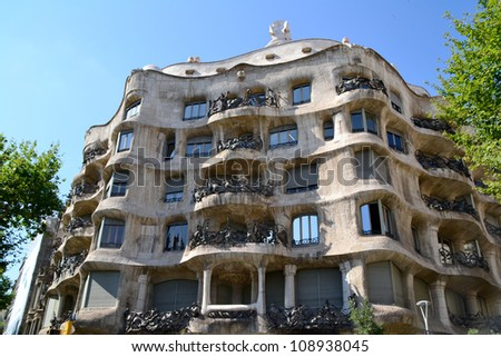 BARCELONA, SPAIN - JULY 6: Casa Mila or La Pedrera on July 6, 2012 in Barcelona, Spain. This building was designed by Antoni Gaudi. - stock photo