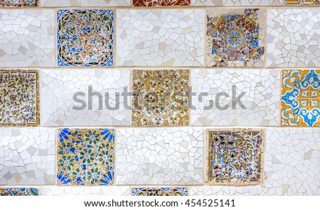 BARCELONA, SPAIN - JULY 3, 2016: Ceramic art in Park Guell in Barcelona, Spain. Park Guell (1914) is the famous architectural town art designed by Antoni Gaudi. - stock photo