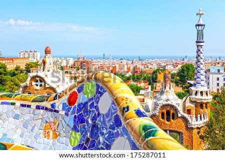 BARCELONA, SPAIN - JULY 19: Ceramic mosaic Park Guell on July 19, 2013 in Barcelona, Spain. Park Guell is the famous architectural town art designed by Antoni Gaudi and built in the years 1900 to 1914 - stock photo